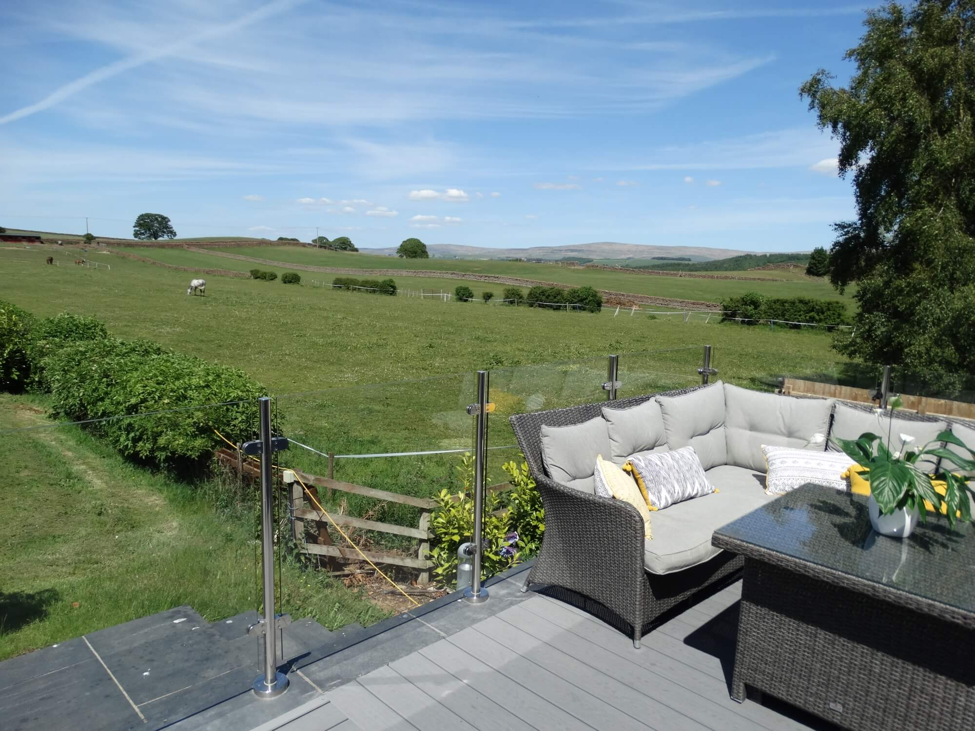 View from deck across green countryside