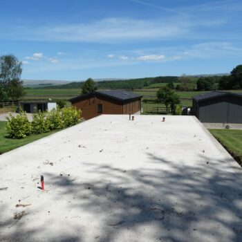 Empty holiday home plot at Moss Bank Lodges
