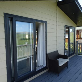 Holiday home decking with french doors