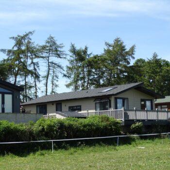 Holiday home exteriors at Moss Bank Lodges