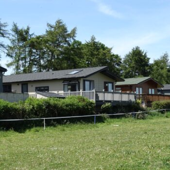 Row of holiday homes with decking areas