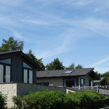 View of holiday home roofs and decks