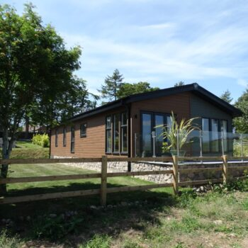 Large holiday home with glass fencing