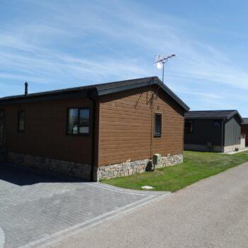 Row of holiday homes at Moss Bank Lodges