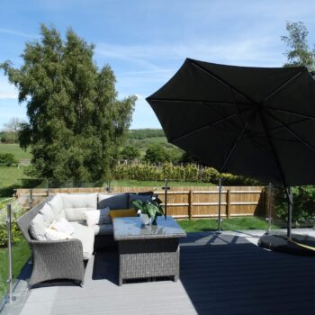Holiday home outdoor furniture and parasol
