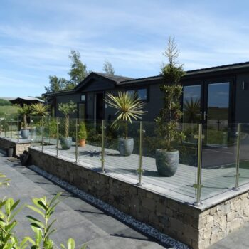 Holiday home with glass around decking