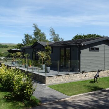 Moss Bank Lodges holiday home with glass fencing